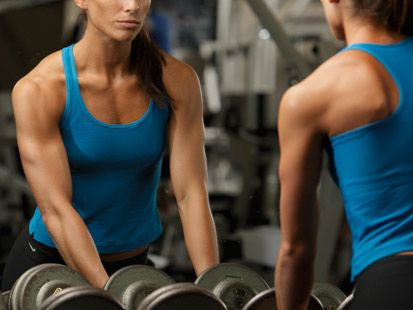 I am a personal trainer on the side and I love lifting weights!  I think all women should want to feel strong rather than skinny!