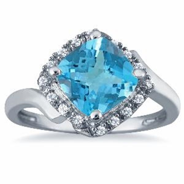 2.50 Carat Cushion Cut Blue Topaz and Diamond Ring in 10K White Gold  2.50 Carat Cushion Cut Blue Topaz and Diamond Ring in 10K White Gold A luxurious ring created in 10K white gold featuring a charming, all natural, flawless cushion cut blue topaz center stone, along with 16 dazzling round diamonds. A very stylishly designed ring featuring the sparkling look of genuine white http://ponderosa.co/szul/2-50-carat-cushion-cut-blue-topaz-diamond-ring-10k-white-gold/