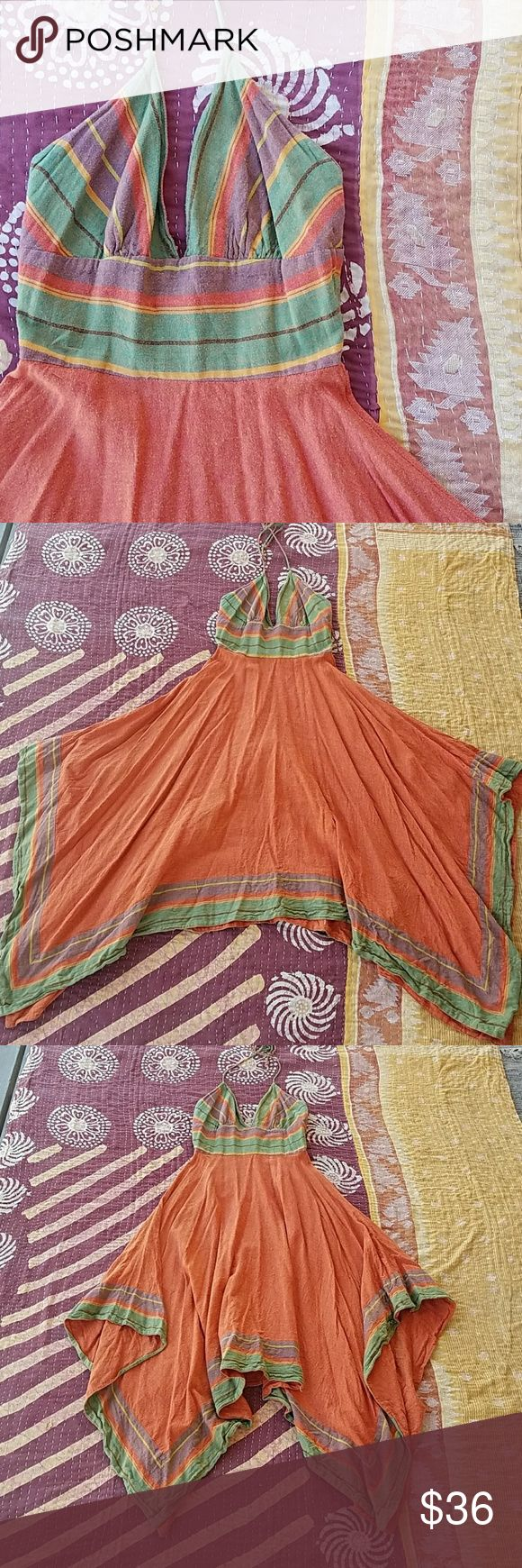 Delia*s Orange Halter Asymmetrical Festival Dress Orange festival halter dress Handkerchief hem  Deep v halter style neckline back zipper Full skirt with asymmetrical hem and colorful border Soft woven fabric perfect for outdoor festivals Made by Delia*s size 3/4 in good condition delia*s Dresses Midi