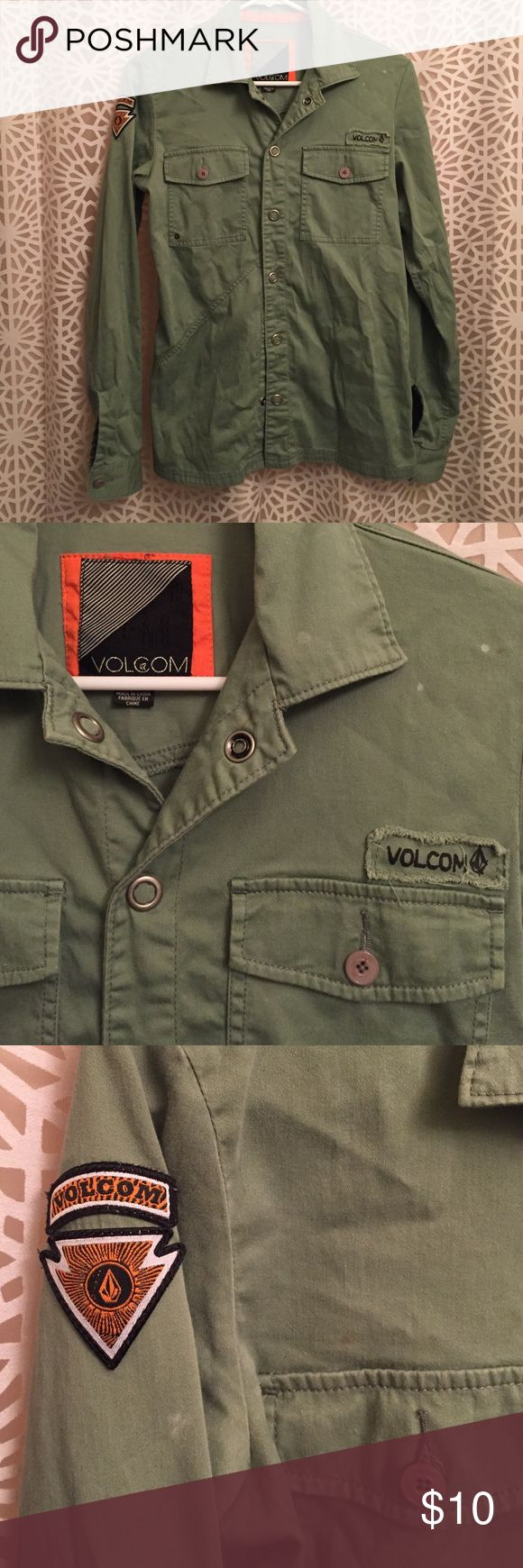 Green Army Style button up Volcom Shirt with snaps 100% cotton. Work once. There are a few small brown and white dots as seen in photos. The shirt came that way so I'm assuming they are supposed to be there. NO LOWBALL OFFERS. Volcom Tops Button Down Shirts