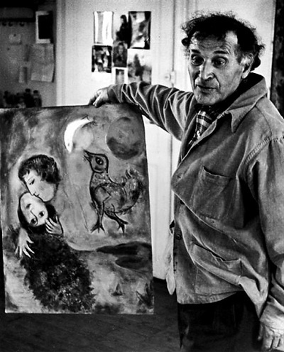 Marc Chagall with his work