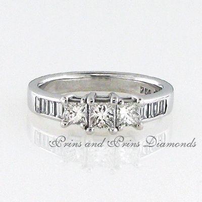 Centre diamond is a 0.697ct GH/VS – SI Princess cut diamond with 2 side princess cut diamonds and 8 x baguette cut diamonds channel set in an 18k white gold shank