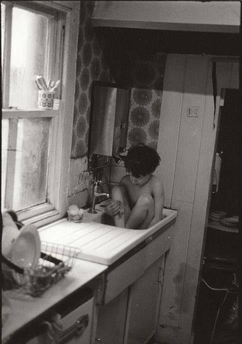 Bathing in the kitchen sink. I was younger than this kid though.