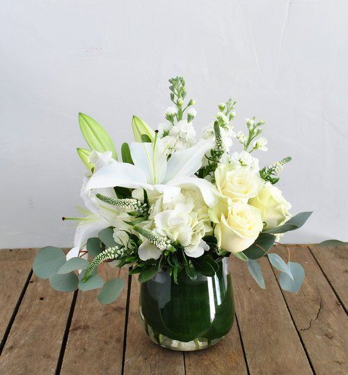 A Crisp And Classic White Color Palette Including Fragrant Stock