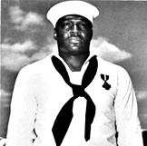 "Doris ""Dorie"" Miller was born in Waco, TX. He joined the Navy as a cook and was in Pearl Harbor during the Japanese attack. He helped carry many sailors to safety and manned an anti aircraft weapon that he had never been trained to use. He was award the Navy Cross for his heroic actions and it was personally presented to him by Admiral Nimitz - head of the entire Pacific Fleet. It was the first time that an African American in the Pacific Fleet received such a high commendation. awesome pin"