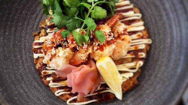 The Chop Shop Food Merchants' Okonomiyaki is a Japanese pancake.