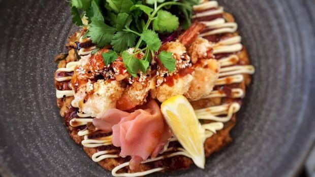 The Chop Shop Food Merchants' Okonomiyaki is a Japanese pancake.