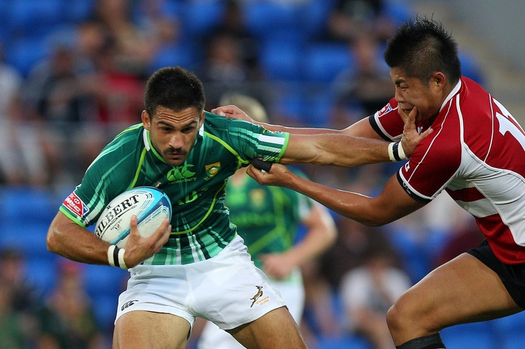 Robert Ebersohn of South Africa is tackled by Daiki Yanagawa of New Zealand during the match between South Africa and Japan on day one of the Gold Coast Sevens World Series at Skilled Park on November 25, 2011 in Gold Coast, Australia.