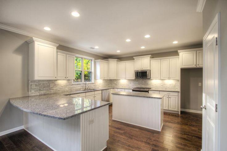 White Kitchen With Gray Quartz Countertops And Dark