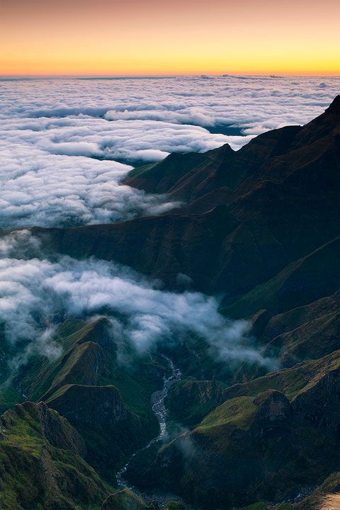 landscape photograph of the tugela river as seen from atop the amphitheater at sunrise. Drakensberg, south Africa