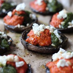 Portabella mushrooms with romesco sauce, fresh pesto and goat's cheese. Vegetarian deliciousness on the table in less than 30 minutes