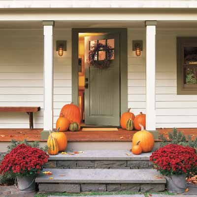 love the combination of the sage green door with the pumpkins  red mums.  like the craftsman style door and light fixtures too.
