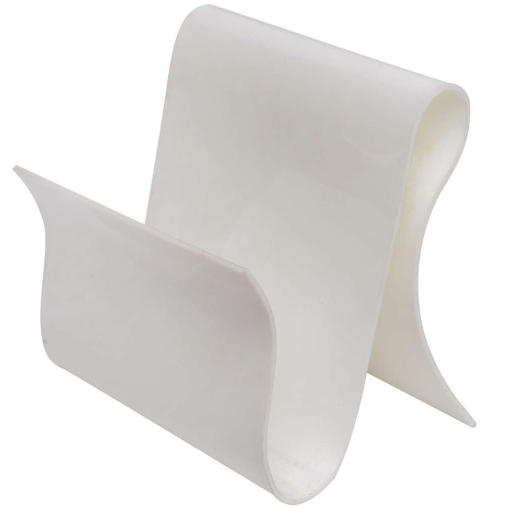 Opaque White Lucite Magazine Rack | See more antique and modern Magazine Racks and Stands at http://www.1stdibs.com/furniture/more-furniture-collectibles/magazine-racks-stands
