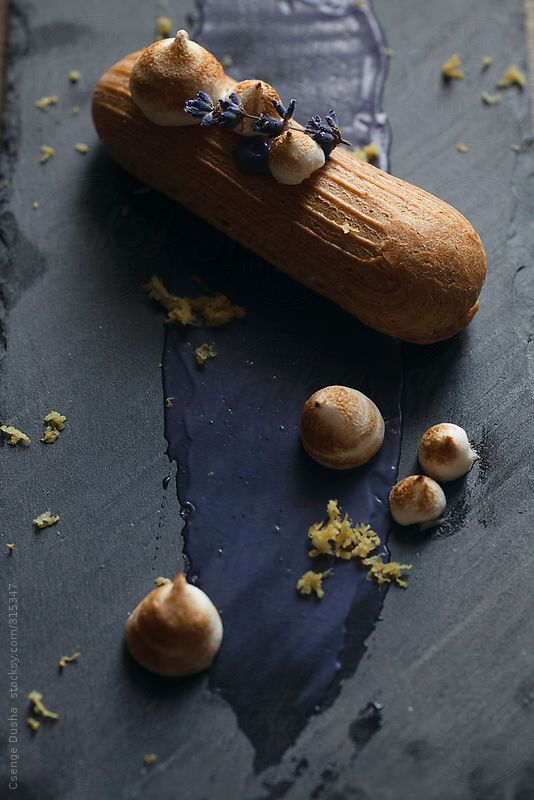 Buttery éclairs filled with lavender pastry cream, lemony toasted meringues, lemon zest