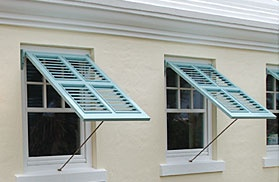 I like these Bermuda shutters. Typically used for sun screening and moderate storm protection, one shutter panel will usually cover the entire window. It is hinged from the top and installed with a custom fit support arm to keep the shutter in an open position - perfect for capturing ocean breezes during long afternoon siestas. Bermuda shutters are available in any louver size, with the option of small or large tilt-rods.