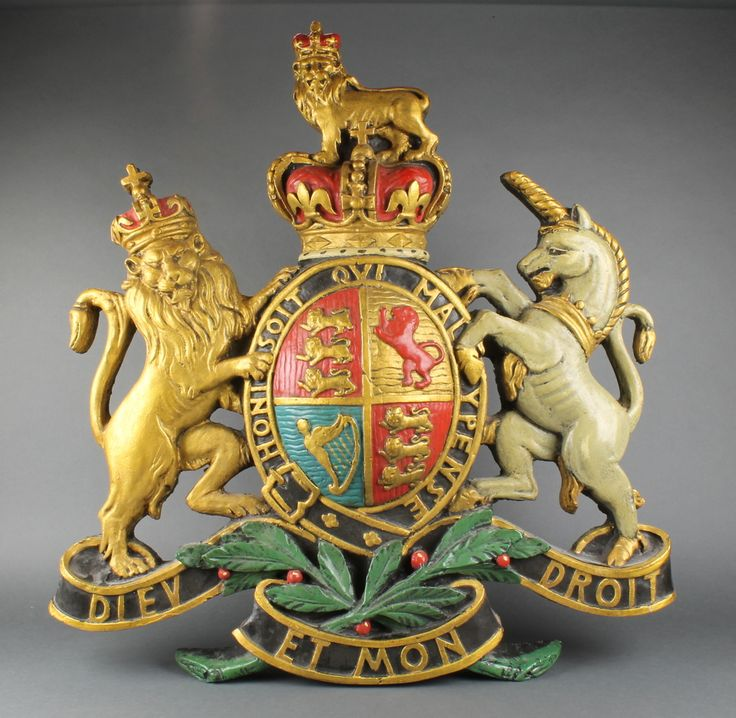 Lot 155, A fibre glass Royal Coat of Arms, sold for £280