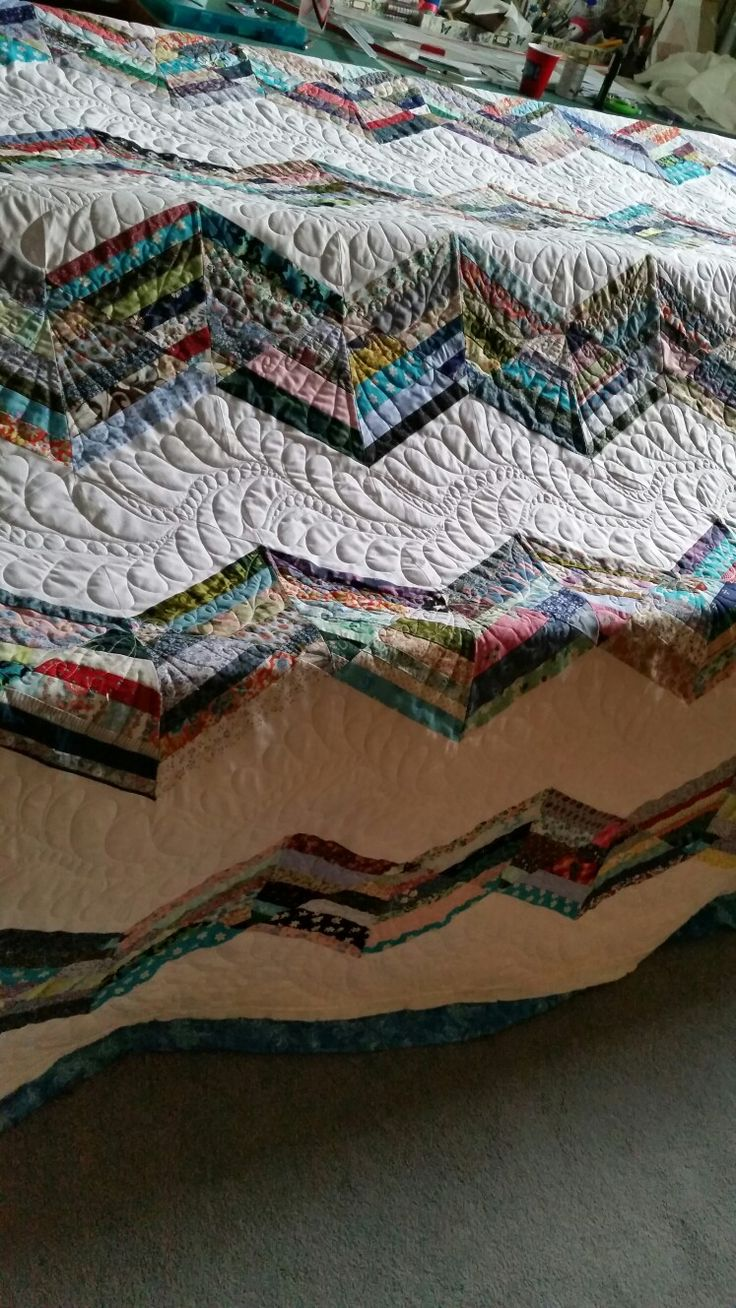 5 Generations of Fabric Quilt! Made with strips cut into 60 degree triangles, then sewn into chevron design.