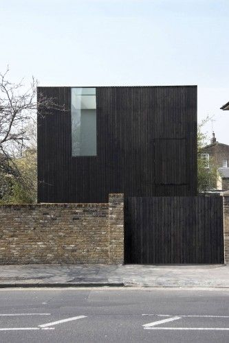 Sunken House by Adjaye Associates in northeast London. The timber used to clad the exterior has been stained a rich, dark brown and hemp was used to insulate the walls.