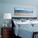 water picture over headboard ---beach bedroom decorating ideas
