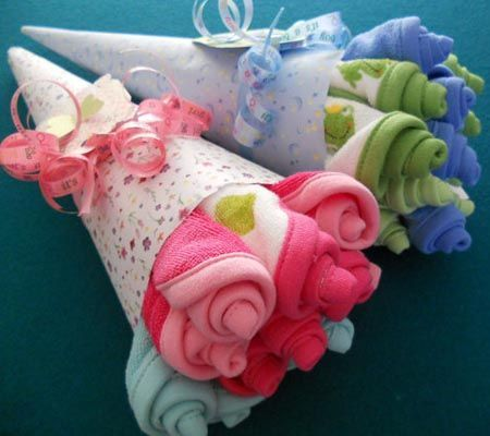 How beautiful is this Baby Socks Bouquet and it's perfect for a baby shower! We've also included Diaper Cakes and adorable Cupcake Onesies for you to make.