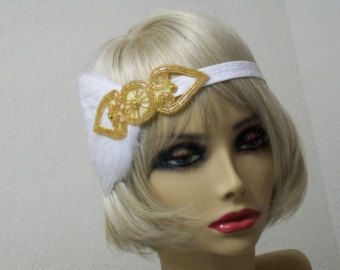 1920s Flapper Fashion, Great Gatsby, 1920s headpiece, Rhinestone headband, 1920s Hair accessory, Art Deco style, Vintage inspired  Vintage is a great way to add some fun and individual style to your wardrobe.  This stunning 1920s Downton Abbey vintage inspired Art Deco flapper headband is the perfect accompaniment for any styled event.  Features a beautiful Crystal Rhinestone brooch on a black velvet stretch headband. So easy to slip on and off and easy placement.  This headpiece has black…