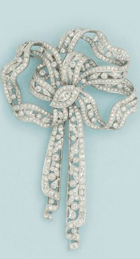 A diamond brooch  Of brilliant-cut diamond ribbon bow design with matching drops and marquise-cut diamond centre diamond detail