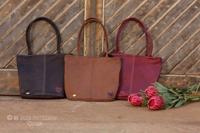 Dark brown, Tan, Ruby, colours of our Full leather Bags. Nelly Bags