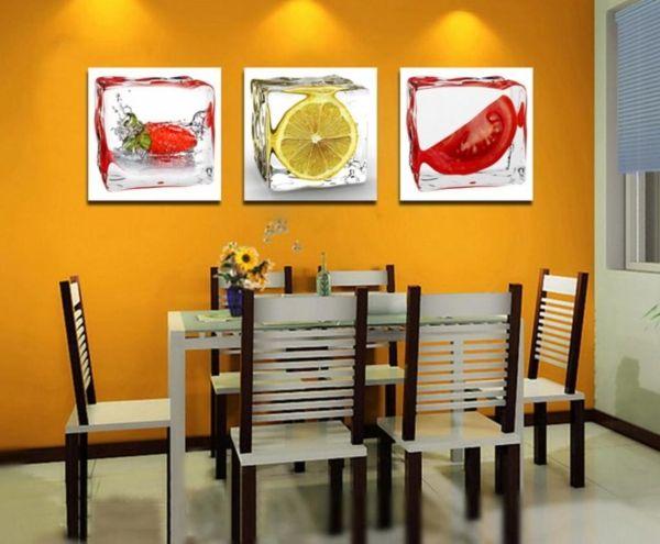 küchenbilder gelbe wand drei bilder nebeneinander