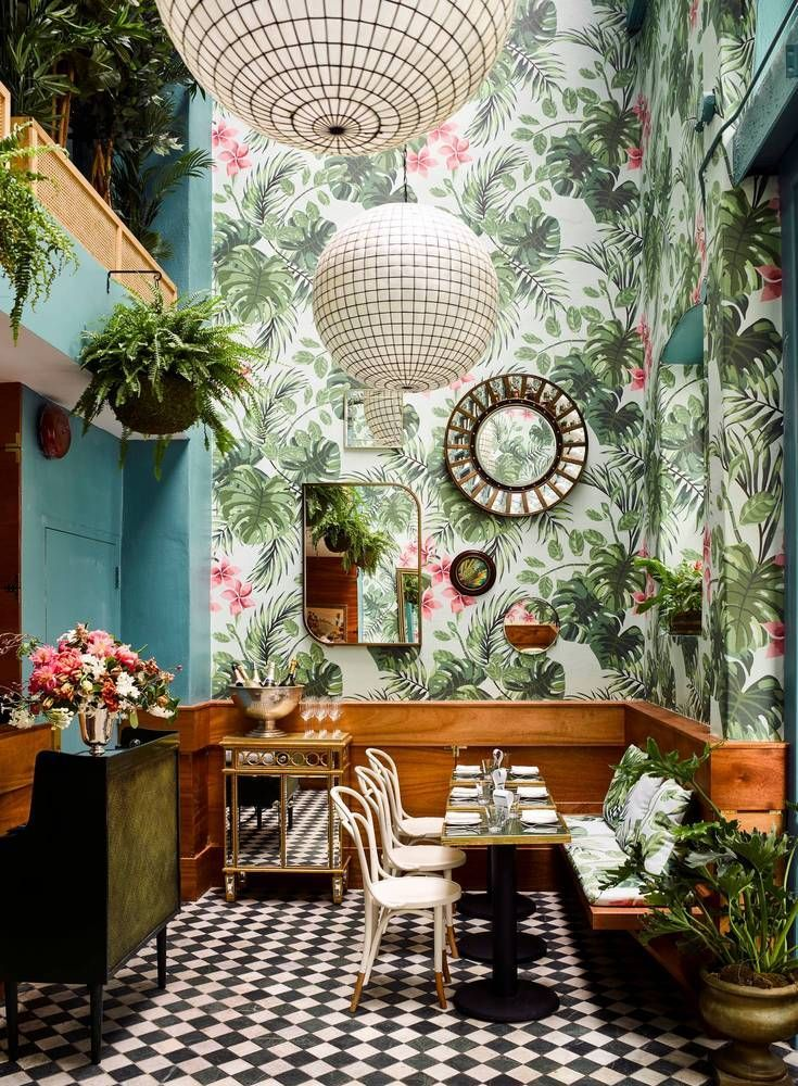 Create a garden inside. Floral wallpaper, mezzanine filled with plants, dining area.