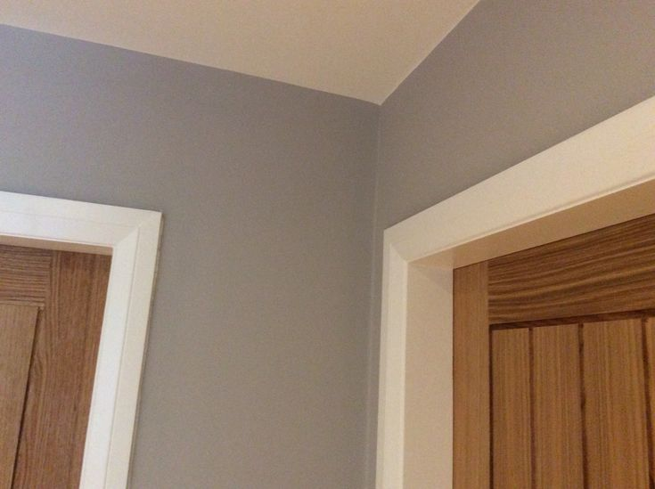Farrow & Ball's Purbeck Stone goes perfectly with Danish Oiled Oak Doors and wimborne white woodwork