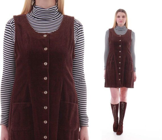 Thick brown medium wide wale corduroy dress. Sleeveless, short length, unlined, front patch pockets and light brown button front closure.