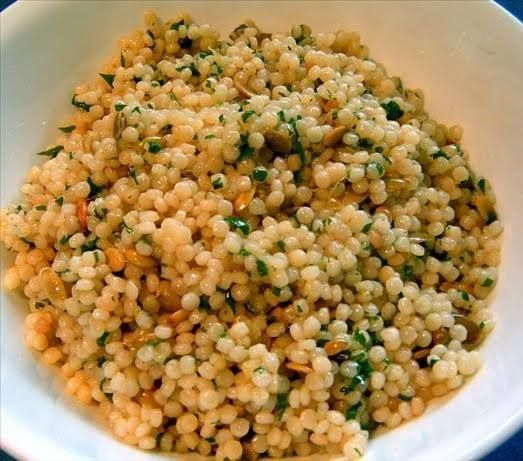 Heat 1 ½ cups of water with salt in a pan. Add the couscous when water boil. Switch off the stove and wait 5 minutes. Fluff  couscous with fork. Heat oil in a kadai add mustard seeds, cumin seeds, urad dal, chana dal, curry leaves and fry until the dal turn to light brown color. Now add the green chillies, ginger. Add salt, lemon juice, turmeric powder, mix well and switch off the stove. Now add the couscous and stir well so that all the masala is mixed. Serve it hot with bowl of sambar.