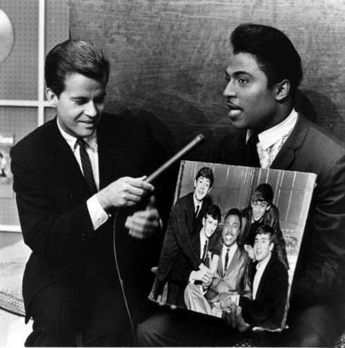 Dick Clark with Little Richard on Bandstand. Little Richard is telling Clark about having The Beatles open for him - The Beatles had opened for Little Richard in Hamburg and a few places in England. Brian Epstein had arranged those gigs hoping Little Richard's fame would bring attention to The Beatles.