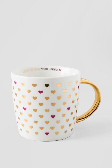 For the girly gal in your life ^_^ Gold Love Is All You Need heart ceramic 14 oz mug $14 from Francesca's