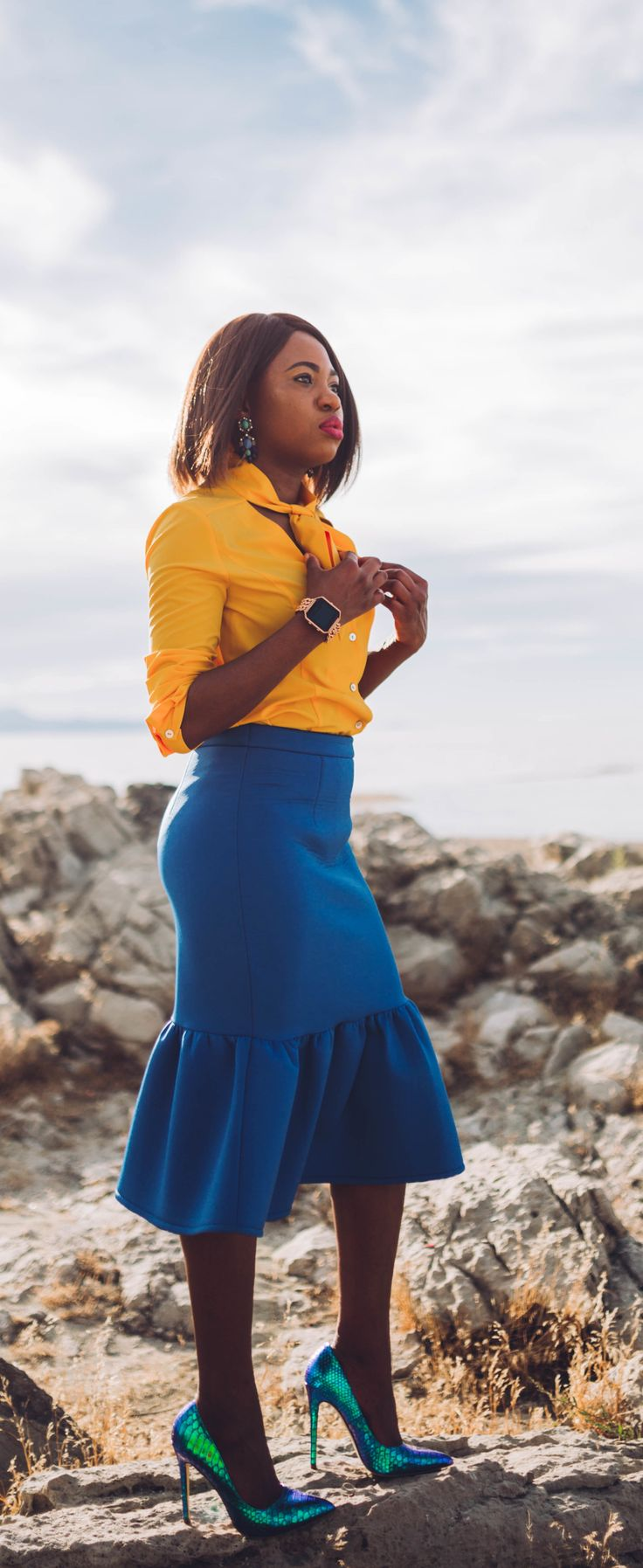 Never thought blue & yellow would look this good! Very work appropriate and stylish with the neck tie bow and peplum midi skirt.   Work style, dressy outfit, women's style, black girl, Nigerian blogger, pussy bow top, neoprene skirt, iridescent hologram heels