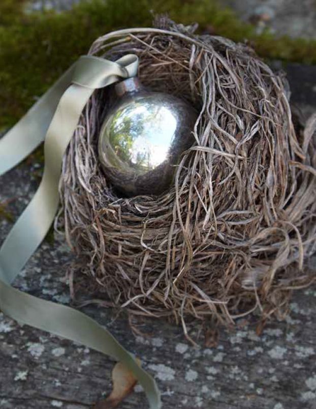vintage  silvery christmas ball in a fallen birds nest, soon to be tucked into the Christmas tree...photo by Marili Forastieri, for Life|Style: Elegant Simplicity at Home, by Tricia Foley