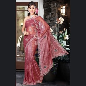 Ready pleated shimmer saree in peach color with applique work