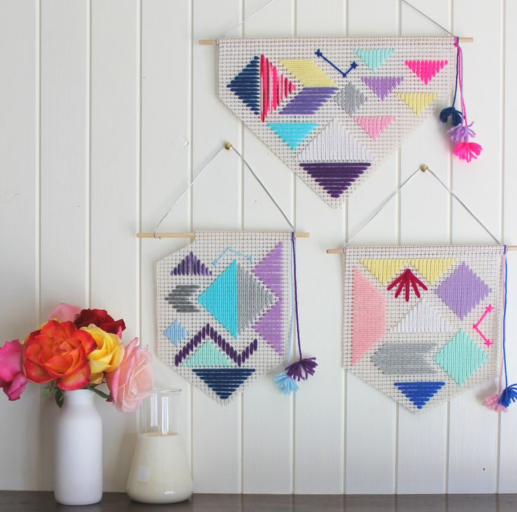 Mixture of colourful hand woven wall hangings by Fizzy Lime