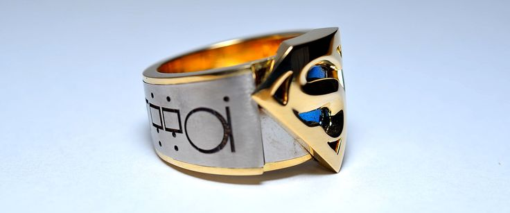 """Handmade """"Man of Steel"""" Laser engraved titanium and 18ct yellow gold Superman ring"""