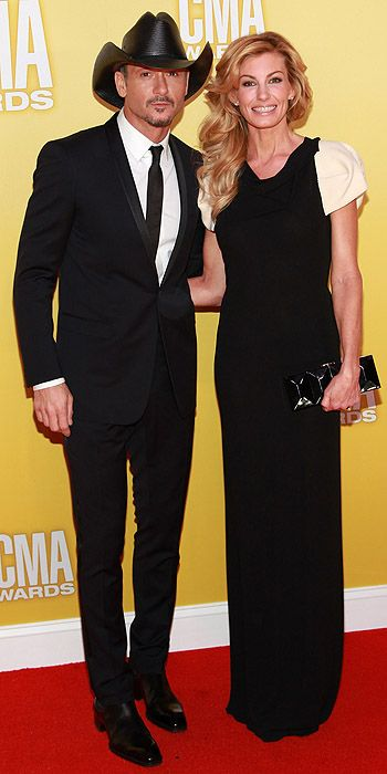 Tim McGraw & Faith Hill....this man seriously gets better with age! <3