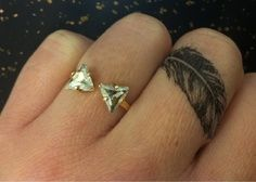 Feather ring tattoo