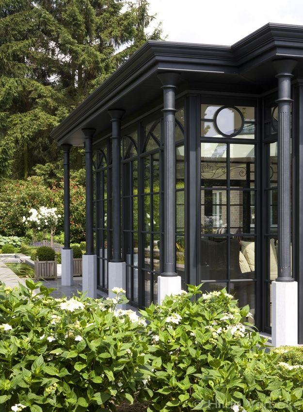 Verfijnde oranjerie ingericht met Flamant meubilair, aluminium veranda | De Mooiste Veranda's