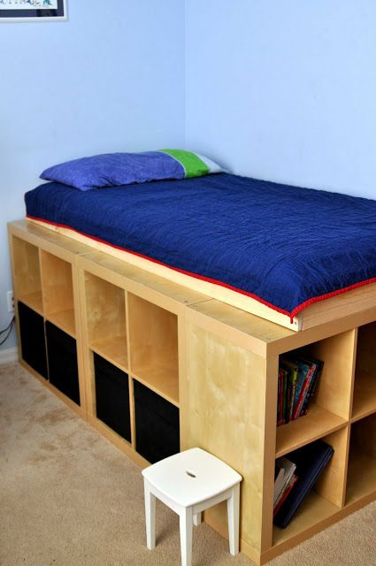 """EXPEDIT storage used as """"bed legs"""". http://www.ikeahackers.net/2011/12/expedit-storage-bed-2.html"""