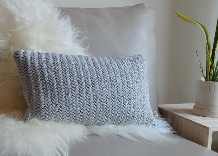 This contemporary chunky herringbone knit cushion cover is right on trend and can be perfectly styled on your sofa or used to soften the look in your bedroom. It looks equally as good placed in a comfy spot on your favourite chair. Lovingly hand knitted using organic cotton yarn, it features a cr