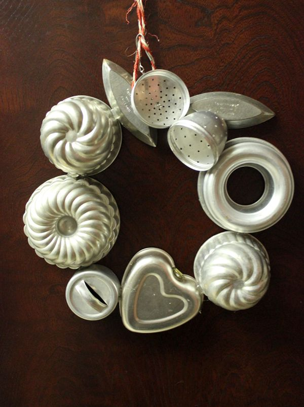 Wreath made out of jello molds and cookie cutters, would be great for a bakery shop