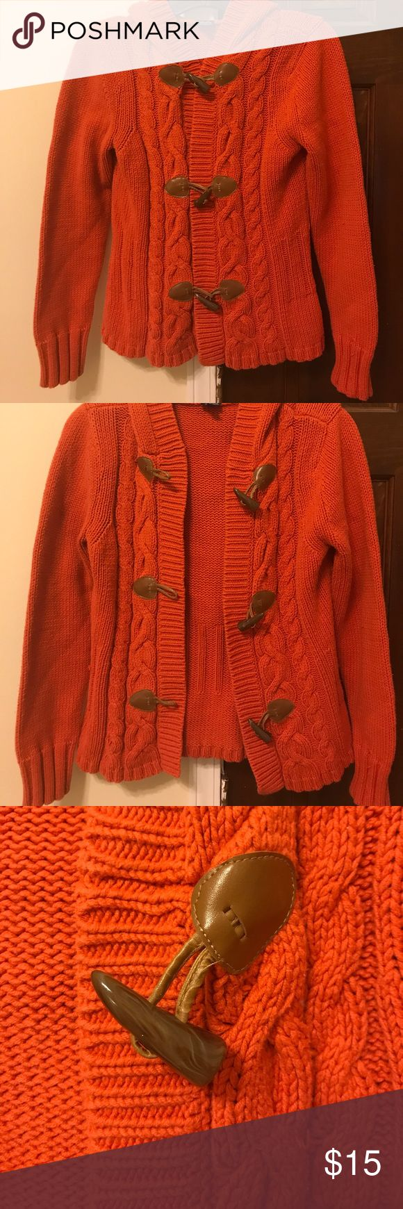 Orange hooded sweater Very cute, fashionable knit sweater with hood. Burnt orange color. Has 3 eyehook closures with cute wood pieces detailing. Very good condition. No snags or flaws. Perfect for the start of fall 😊🍂🍁🍁 Rafaella Sweaters