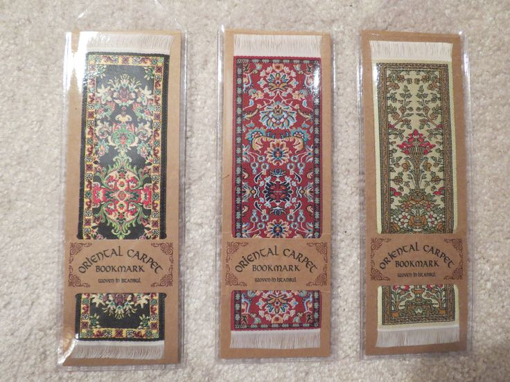 """From left to right here are the Isfahan (Persia, circa 1650), Tabriz (Persia, circa 1710) and Hereke (Turkiye, circa 1835) bookmarks.  The Isfahan and Tabriz have  matching 7"""" x 9"""" carpets."""