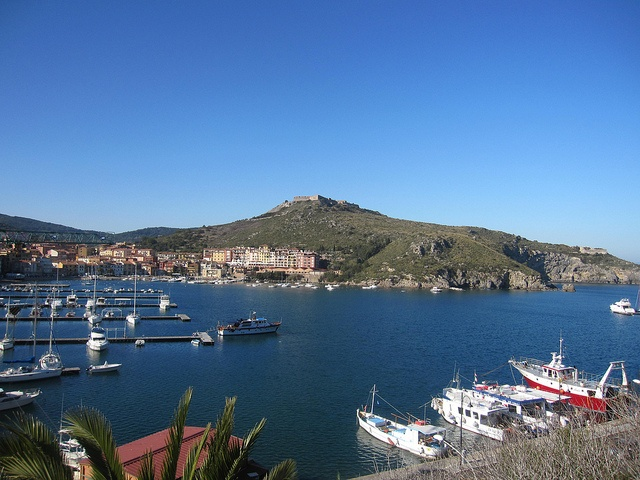 The tourist harbour of Porto Ercole in Spring, season starting! The Fortress of Forte Filippo on the top of the hill. Port Ercole, Monte Argentario, Costa d'Argento, Maremma, Tuscany, Italy