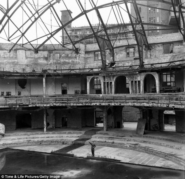 It's pver: A U.S. soldier, PFC Douglas Page, offers a mocking Nazi salute inside the bombed-out ruins of the Berliner Sportspalast where the Third Reich often held political rallies: Pfc Douglas, Nazi Salutation, Hitler Bunker, Salutation Inside, Sports Palaces, Berlin Sportspalast, Rare Photo, Fall Photo, American Soldiers