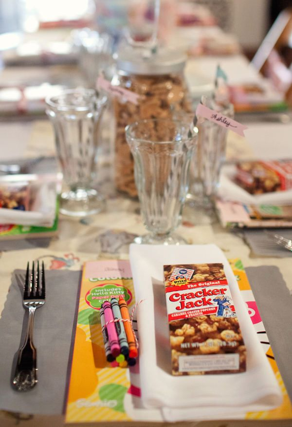 have a table just for kids with coloring books, and kid snacks at my wedding